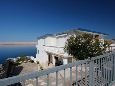 Photo for Apartment Valentina with pool and sea views DIRECTLY on the beach / sea