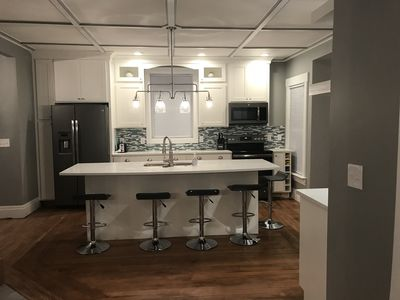 Photo for Amazing Renovation in 2018, 1 block to town; 5 blocks to the beach & a HOT TUB!