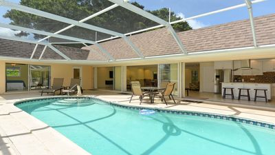 Photo for Newly Renovated Canal Front Home, Heated Pool, Steps to the #1 Beach in the US