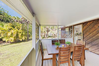 Screened Patio - Step out to the screened patio and see the verdant beauty of the private backyard.