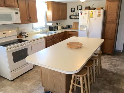 Large, fully-equipped eat-in kitchen. Icemaker. New stove. W/D laundry closet.