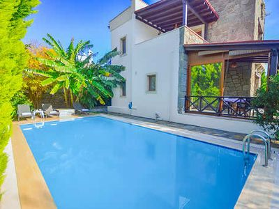 Photo for A five minute walk fto the splendid Marina, beaches and old town of Yalikavak, Mete is a tranquil villa with a pool, terrace and walled garden, Wi-Fi , Air conditioning, pool towels and blue tooth speaker. A real home from home!