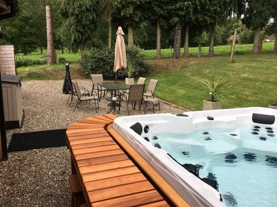 Enjoy the relaxing hot tub and outdoor dining area