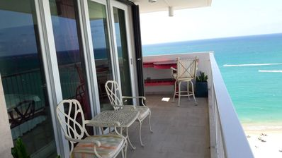 Photo for Beach Front Paradise 180 degrees of ocean view