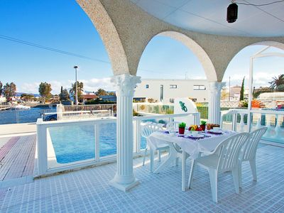 Photo for Beautiful apartment for 8 guests with A/C, private pool, WIFI, TV, balcony and parking