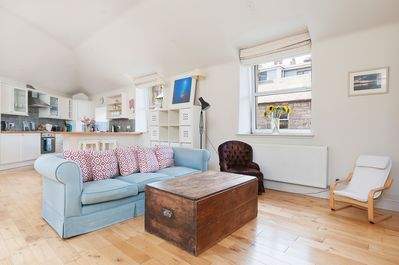 Open plan, light and bright living area and kitchen on first floor