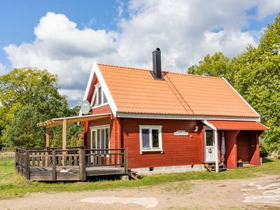 Photo for Cozy log cabin near the Baltic Sea, ideal for fishing and relaxing