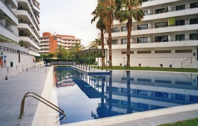 Photo for APARTMENT WITH TERRACE AND POOL NEAR BEACH AND PORT AVENTURA