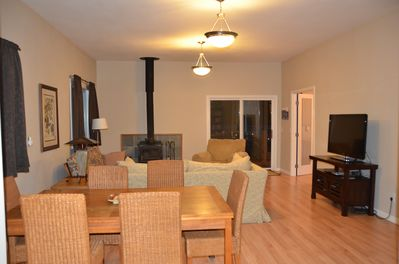 Living room with futon, wood stove, cable and wifi. Deck and views of river.
