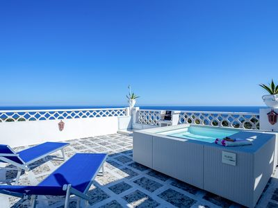 Photo for Seaview apartment with beautiful terrace with BBQ deck rocking