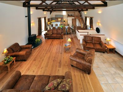Photo for Large 5 star barn conversion on Exmoor, sleeping 16 guests in 8 ensuite rooms.