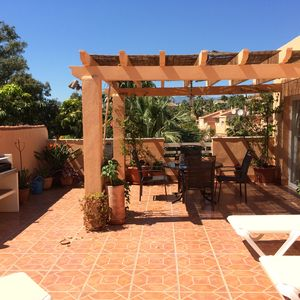 Photo for Stunning penthouse apartment with private terrace near Puerto Cabopino beach
