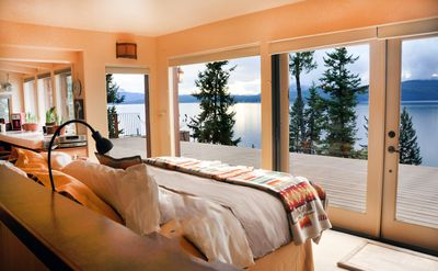 Awaken to incredible views from your king size bed overlooking the lake.