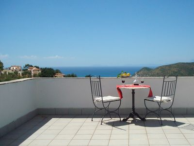 Photo for Small, fine apartment with panoramic sea views in a tranquil green location