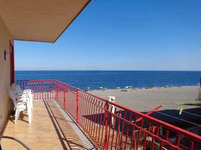 Photo for beautiful seafront apartment with direct access to the beach