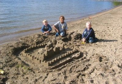 Building sand castles with friends