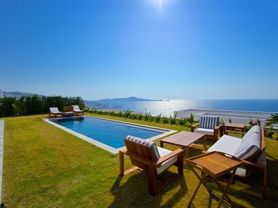 Photo for Luxurious seafront Mediterranean villa with pool