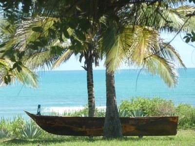 Have a drink in our sofa-boat looking at the turquoise waters...