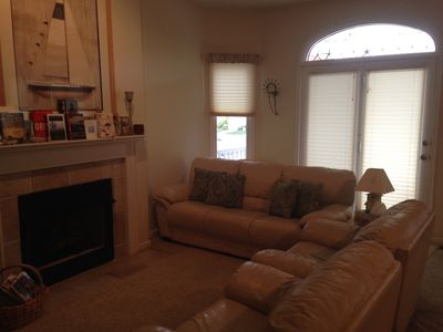 Relaxing Family Room, Leather sofa and 2 chairs, 50' flat screen tv