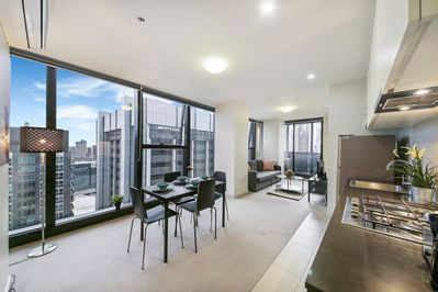 A spacious living with a panoramic view over the city.