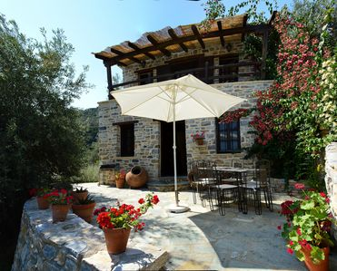 Photo for Stone Cottage in traditional Greek village with spectacular sea views