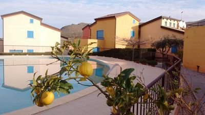 Photo for Near Iles Rousse air-conditioned apartment with swimming pool 4 people near the sea