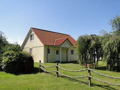 Photo for Modern, cozy wooden house with large garden and secluded sitting area in tranquil Stangheck, just 5km from the Baltic Sea beach. Enjoy your holiday as a couple or together with the family in the beautiful Angelner region!