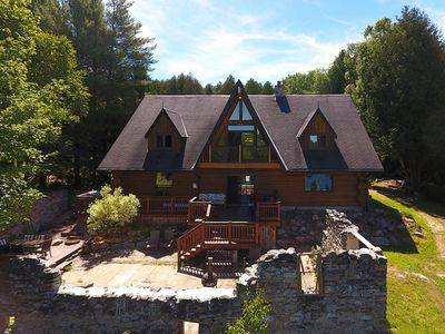 Photo for Stunning Log House on a Private Lake