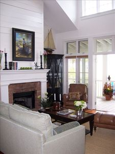 Elegant furnishings surround gas fireplace in living room