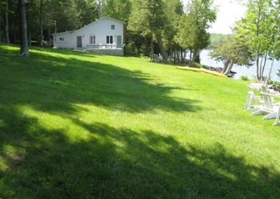 Maine house front yard and Lake House