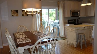 Open Concept 2nd Level Dining Room Table w/ Deck, grill removed due to a fire code.
