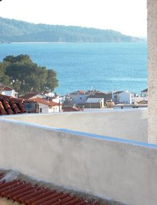 Photo for Beautiful apartment overlooking the town, sea and mountains of Skiathos island.