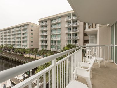 Photo for Full-Service Apartment   Balcony, Full Kitchen, Pool + Hot Tub Access