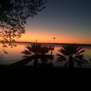 Photo for LAKE HOUSTON WATERFRONT property with hot tub; huge decks, sunsets, fish, swim!