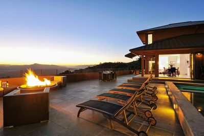 Pool deck and firepit with indoor and outdoor dining areas
