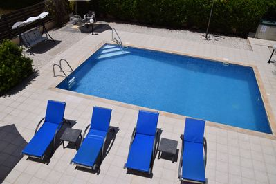 Pool with walk-in steps and large private sunbathing areas all around.