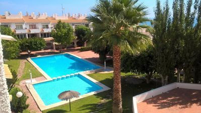 Photo for Apt in lovely Gardens, Large Pool, Steps from the Sea