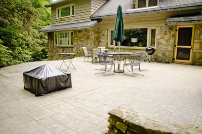 Nice large stone patio with charcoal grill, fire pit, two table/chair sets