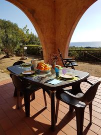 house Costa Rei with beautiful beach and terrace with fine viewCasa con giardino