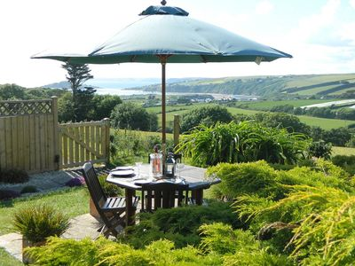 LUNCH IN THE GARDEN JUST BY THE BBQ. THE SEA VIEW, BURGH ISLAND IN THE DISTANCE