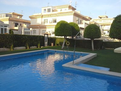 Photo for House By The Pool, Beach And Golf. Walk to Zenia Boulevard, beach & amenities.