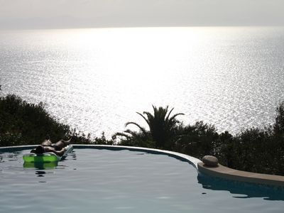 Photo for Fantastic villa with infinity pool on the sea, 4 rooms with private bathroom