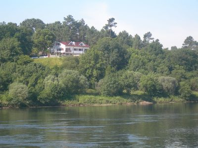 Photo for Portuguese / Spanish border waterfront villa, pool, direct river access, 6 beds
