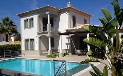 Photo for Modern, Contemporary 4 Bed Villa with Heated Infiniti Pool in Vila Sol Vilamoura