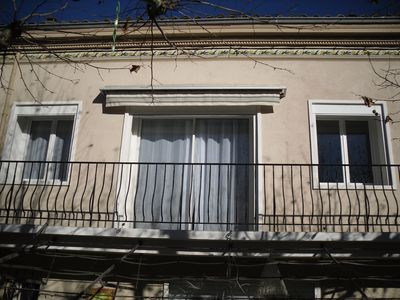 Photo for house in the heart of the village with balcony overlooking a typical Provencal square