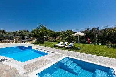 Huge outdoors with : pool, hydromassage, seating areas, playground, etc.