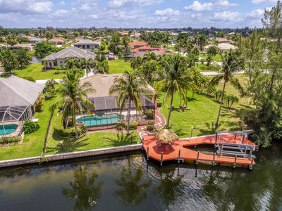 Photo for Spacious canal front home with private heated pool and boat slip!