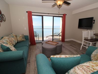 Spectacular view Ocean front living room large flat screen tv and pull out couch.