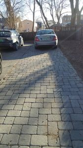 Off street parking on right side, cobblestone driveway
