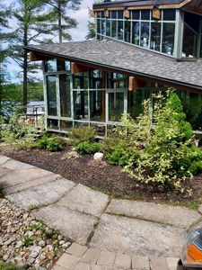 Photo for Stunning custom built glass house on the shores of Lake Rosseau